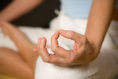kundalini: Yoga pose with mudra hand
