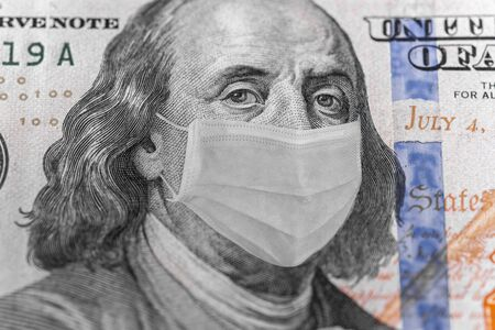 Photo illustration of Ben Franklin in a mask on a dollar 100 bill. Displays problems in the world and in the economy of different countries Stock Photo