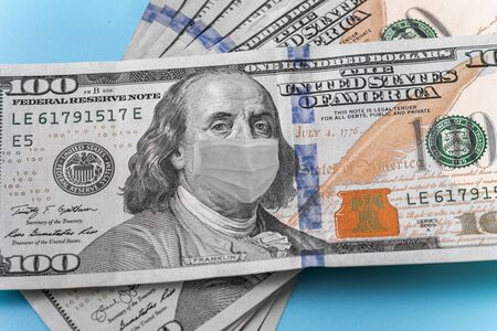 Photo illustration of Ben Franklin in a mask on a dollar 100 bill. Displays problems in the world and in the economy of different countries
