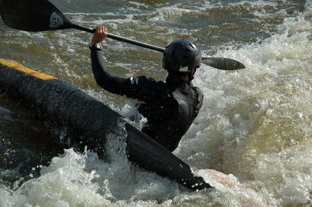 Close-up shot of a kayaker fighting the rapids