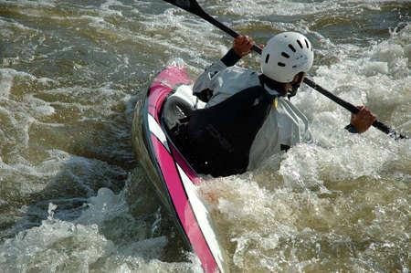 kayaker: Close-up shot of a kayaker fighting the rapids
