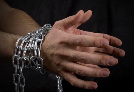 Photo of man's hands in chains Stock Photo - 8497723
