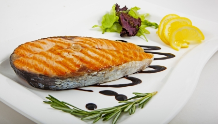 Photo of fish with vegetables on a plate Stock Photo - 23000634