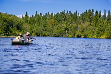 freshwater fishing: Fisherman on the river photo