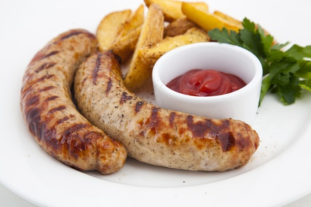 Grilled sausages with potatoes and gravy Stock Photo - 21195814