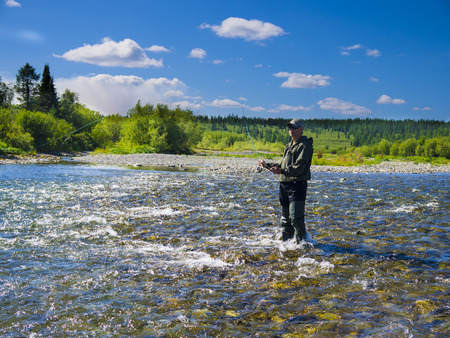freshwater: Photo fly-fishing on the river Stock Photo
