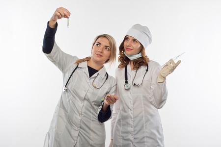 Health workers watching a reaction after the introduction of preparation into a test-tube with counts Stock Photo