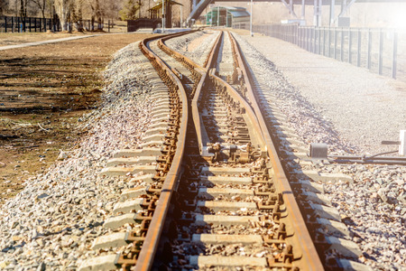 Old narrow gauge railroad tracks the mechanism of balancing the transfer of railway lines
