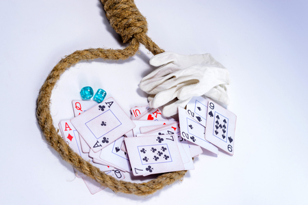 A playing cards, dice on isolated white background, prisoners in a rope loop and covered with white gloves croupier Imagens