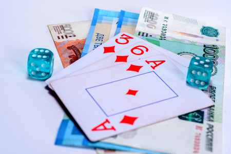 A playing cards, dice and Russian rubles on isolated white background