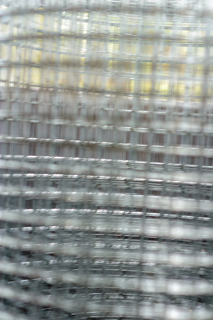 Industrial rolls of aluminum chain link fencing.close up steel wire net texture for background.Rolls of steel wire mesh for use of fencing.Close up of wire mesh fence in roll Imagens