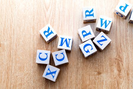 Children's wooden cubes with the Latin alphabet on the wooden floor