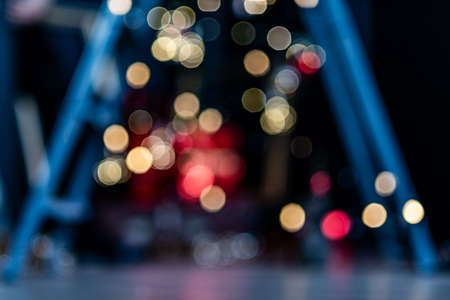 Blurry, abstract background of Christmas lights in a pre-holiday city.