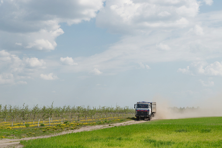 agro: Gomel, Belarus - May 4, 2016: a truck with the awning performs livestock transportation in agro OCTOBER. Editorial