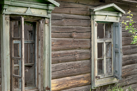 indigence: An old abandoned brick house with a broken window, closeup. As background for design of crisis Stock Photo
