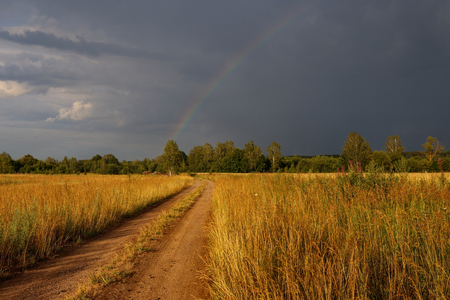 Hope on the road in form of rainbow. Stock Photo