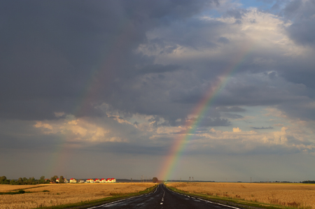 end of rainbow: Hope on the road in form of rainbow. Stock Photo