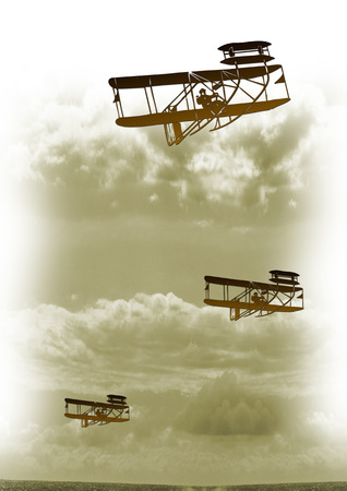 liftoff: A vintage metal bi-plane flying high Stock Photo