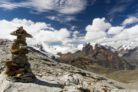 cairn: Cordillera Blanca in Peru with a cairn in the foreground Stock Photo