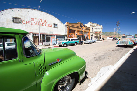 revitalization: old cars on a small-town street in the ghost town of Lowell in Arizona Editorial