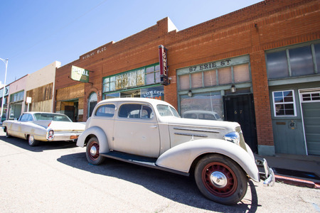revitalization: old cars on a small-town street in Lowell in Arizona Editorial