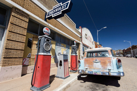 old gas station with an old station wagon in the ghost town of Lowell in Arizona