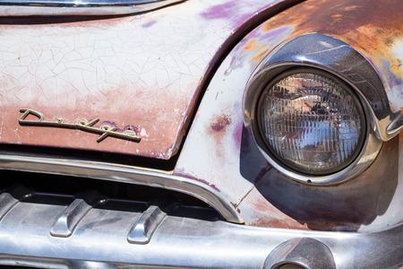 rusty car: headlight on an old rusty classic car