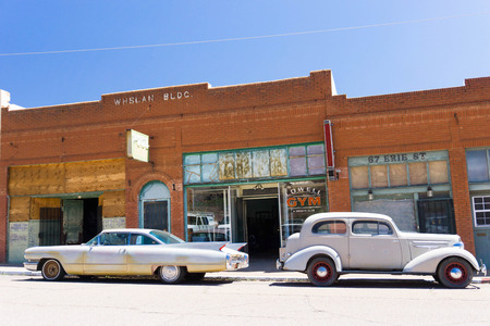 ghost town street with classic cars in a ghost town in Arizona