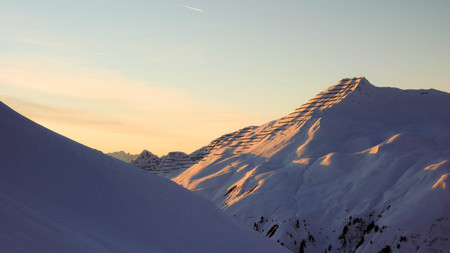 snowcovered: snow-covered mountains at sunset Stock Photo