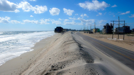 outer banks: sand dune and highway in the Outer Banks Stock Photo