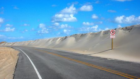 outer banks: Outer Banks highway with protective sand dune