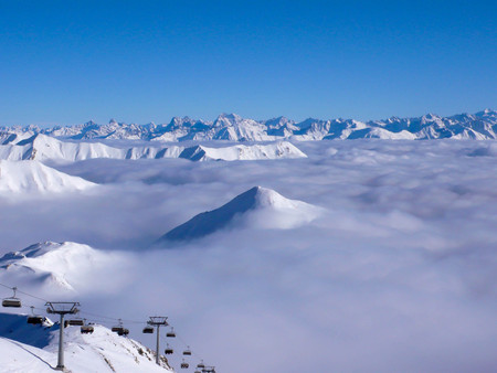 s ki resort in the Alps with a chairlift in the foreground Stock Photo