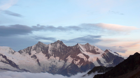 Saas Fee: the Mischabel Massif in the Swiss Alps near Saas Fee at dawn Stock Photo