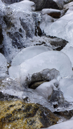 frozen creek: frozen creek with interesting ice sculpture up close Stock Photo