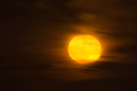 full moon rising in a cloudy sky over the Atlantic Banque d'images