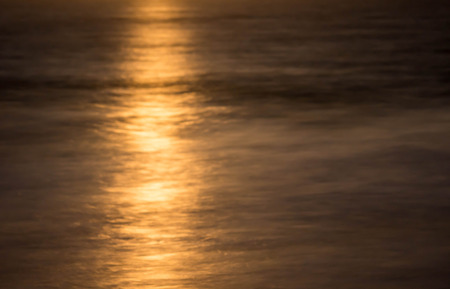 grand strand: reflection of a full moon rising over the ocean