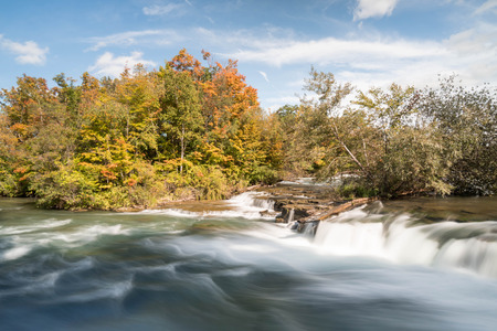 waterfall with fall colors in the background