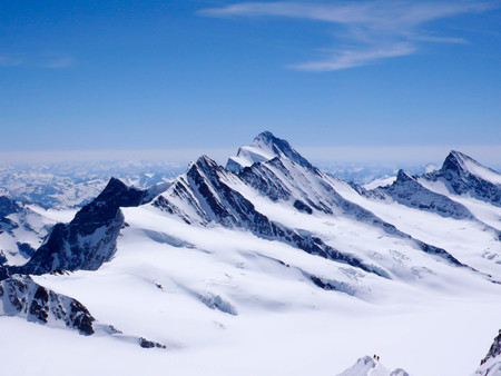 expose: a panoramic view of the Bernese Alps in Switzerland with mountain climbers in the foreground