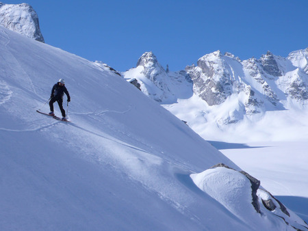 backcountry: backcountry skier on a steep descent in the Forno Valley in the Swiss Alps