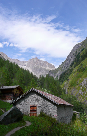 mountain hut: mountain hut in a valley in the Swiss Alps Stock Photo