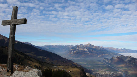 sargans: the Rhine Valley near Sargans with the summit cross of a mountain in the foreground