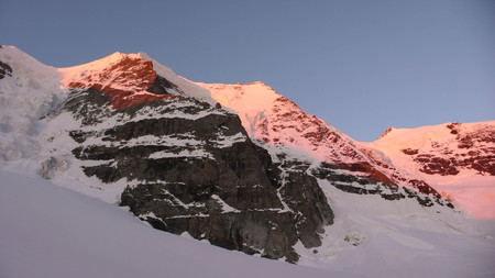 pers: Piz Palu in the Swiss Alps at sunrise with the massive Bumiller Pillar in the foreground