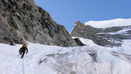 serac: mountain climber on a steep north face in the Swiss Alps