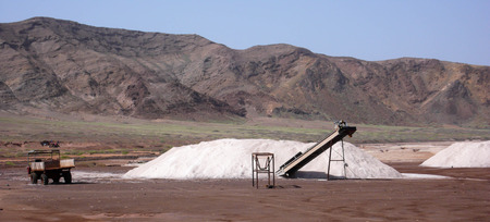 salt mine: salt mine on Sal Island in Cape Verde with salt, a conveyor belt and a truck