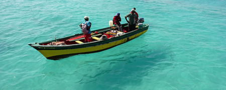 fishermen in a small boat on Sal Island in Cape Verde Stock Photo