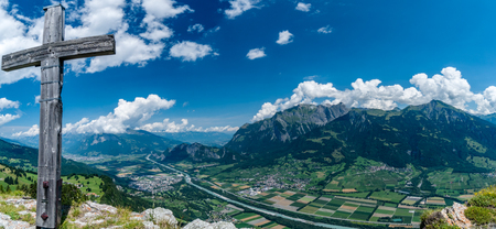 panorama view of the Rhine Valley and Heidiland near Maienfeld in the Swiss Alps on a beautiful summer day