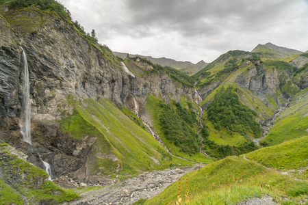 natural amphitheater in the Swiss Alps near Bad Ragaz with five waterfalls under an overcast sky