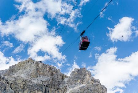 red cable car gondola descending from the Pizzo Pordoi in the Italian Dolomites Stok Fotoğraf