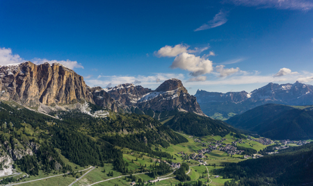 village of Colfosco in the Dolomites and surrounding mountain landscape