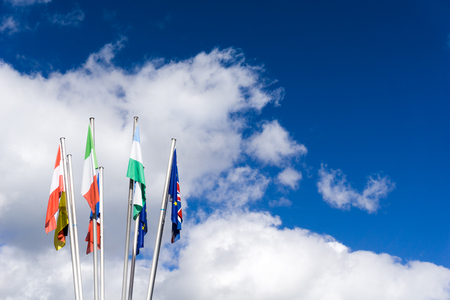 collection of flags from Europe with the EU flag covering the British Union Jack
